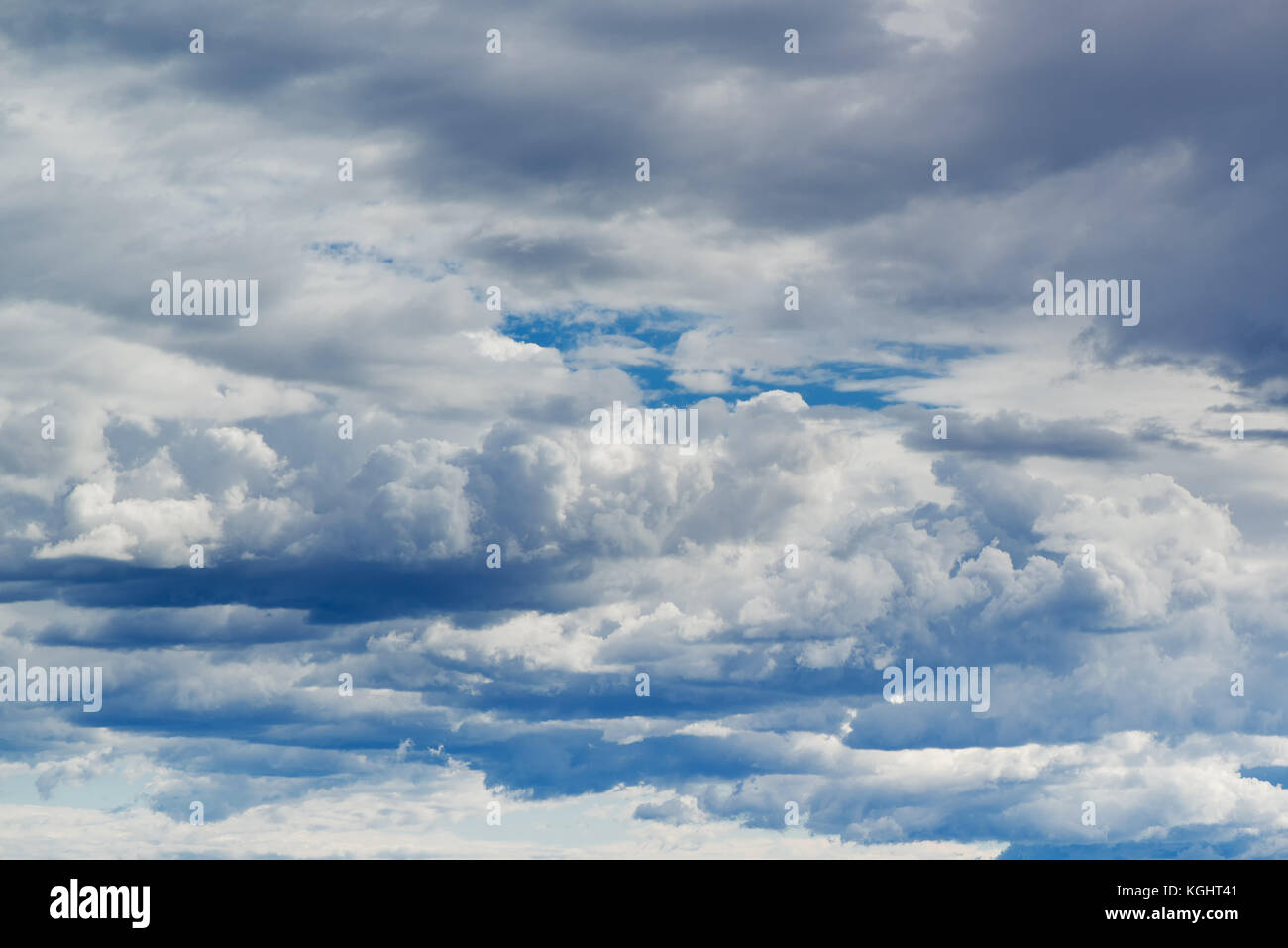 Cloudscape as background, summer sky with white fluffy clouds - Stock Image
