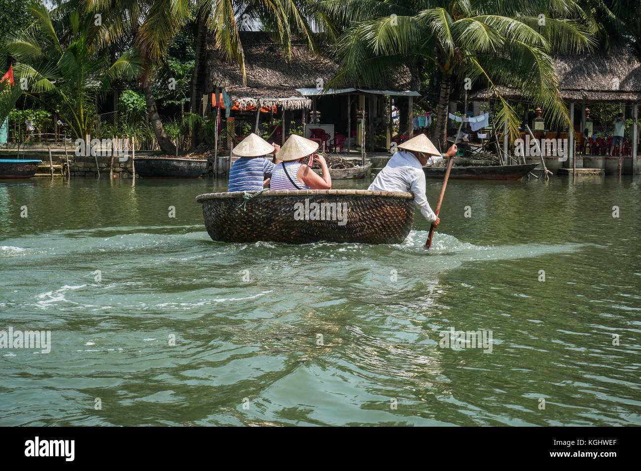 Tourists enjoying tour in traditional coracle boats on river Thu Bon near  Hoi An, Vietnam, south East Asia. - Stock Image