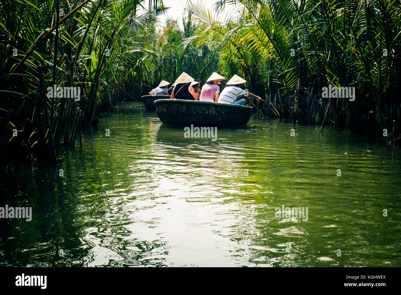 Tourists in traditional coracle boats on river Thu Bon near  Hoi An, Vietnam, south East Asia. - Stock Image