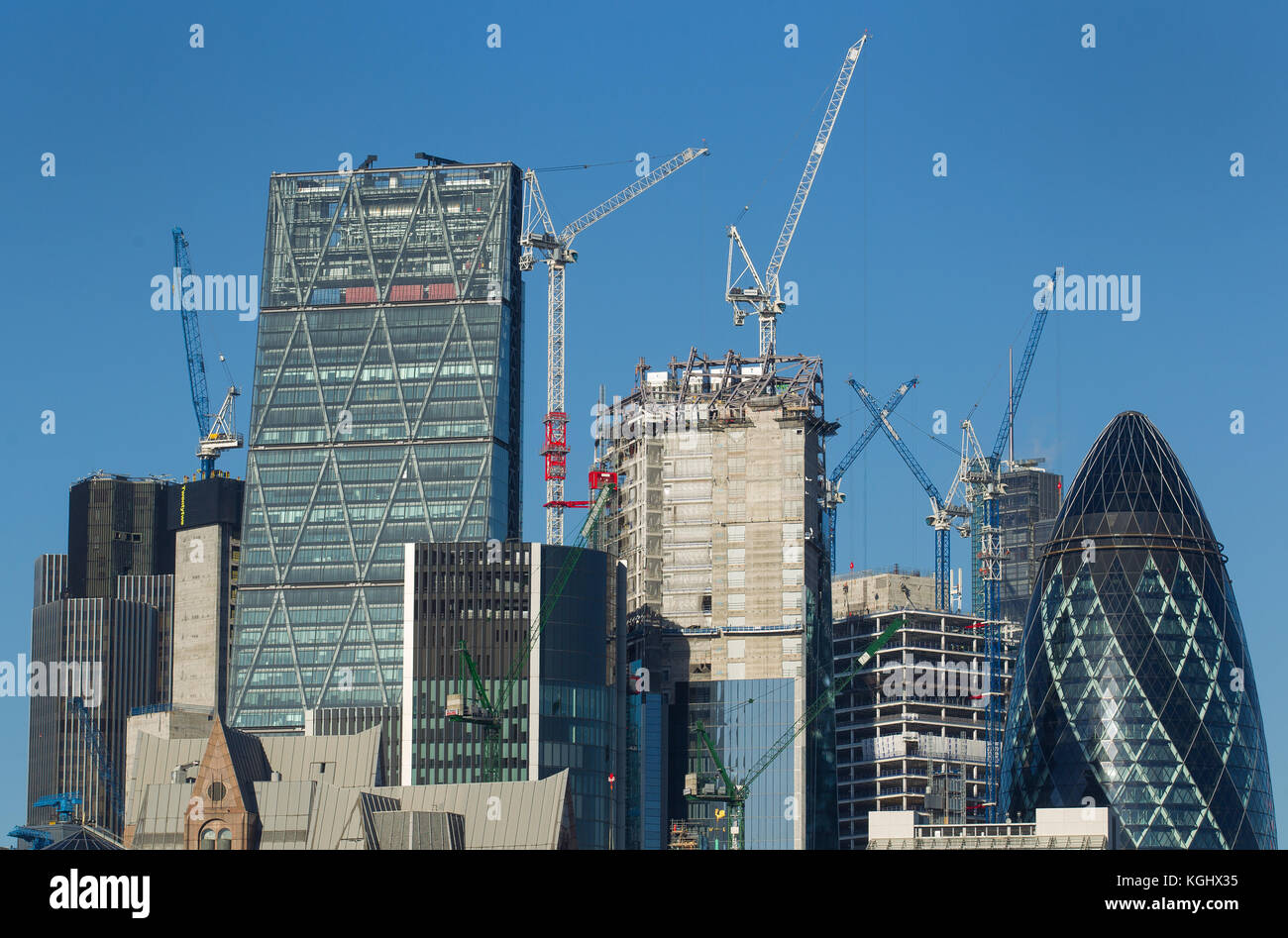 London city skyline seen from the river thames as cranes work on new buildings in the square mile - Stock Image