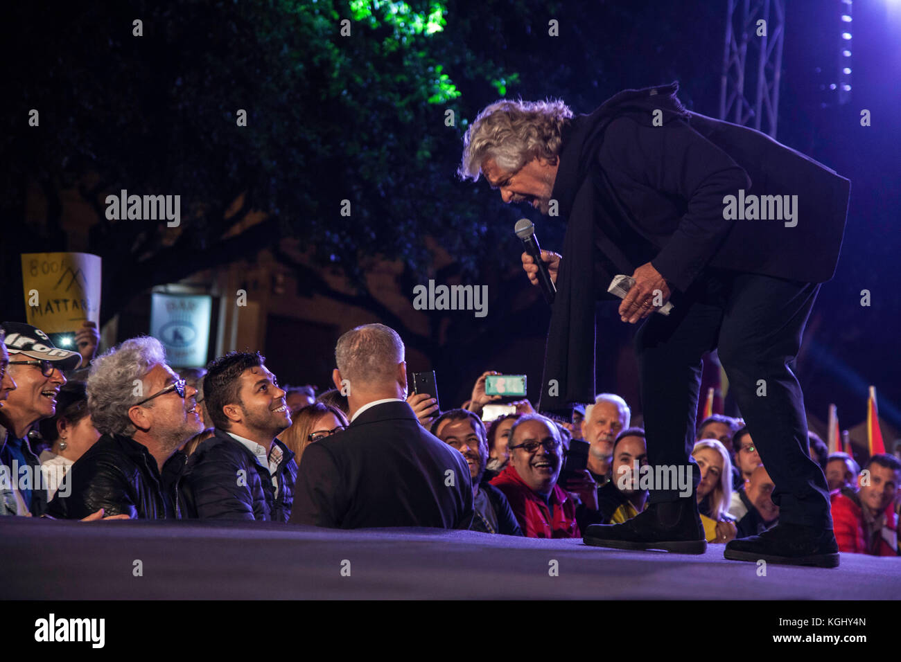 Beppe Grillo, political leader of the Five Stars Movement (M5S), speaks during a political rally before the Sicilian - Stock Image