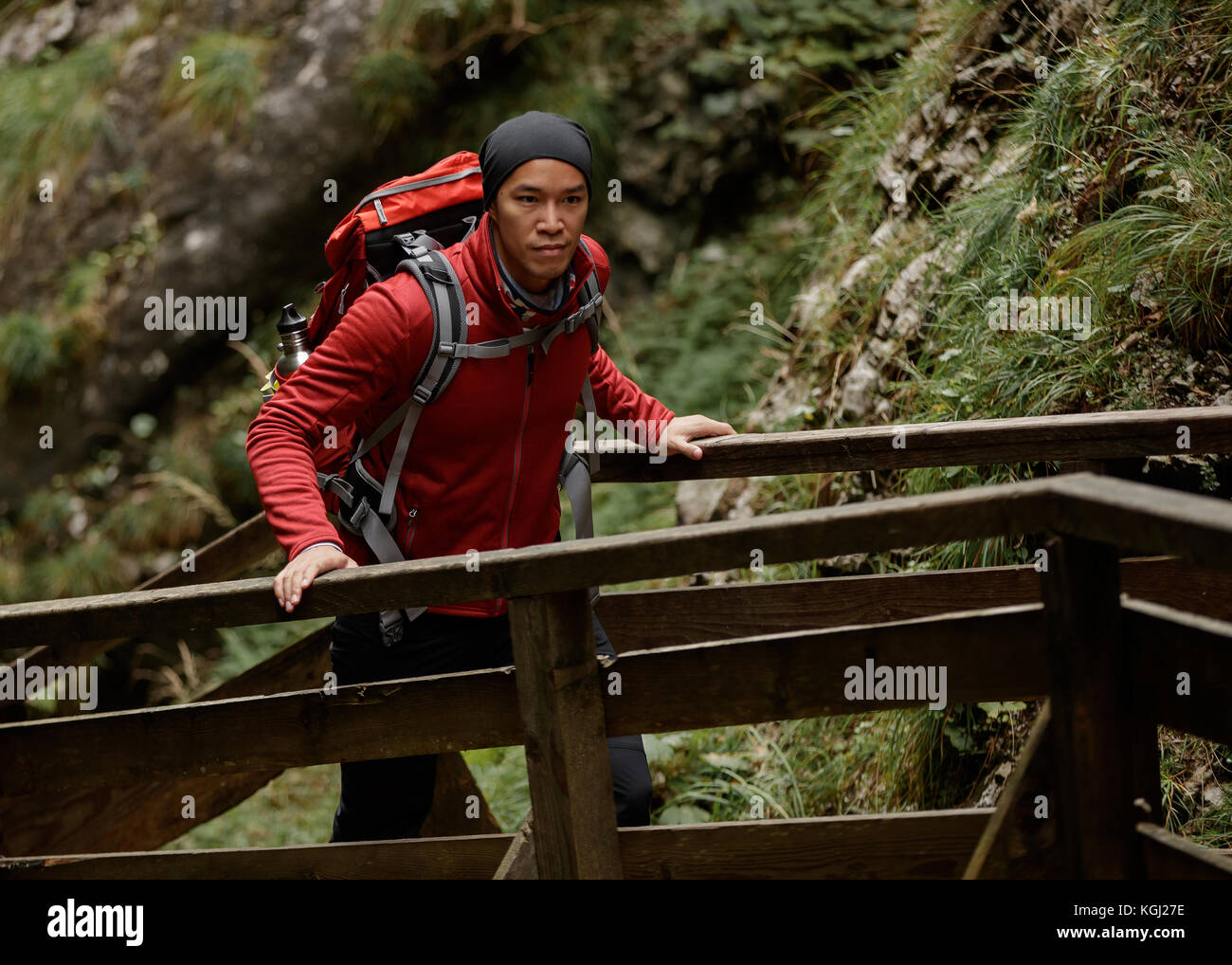 A man hiking along a trail - Stock Image