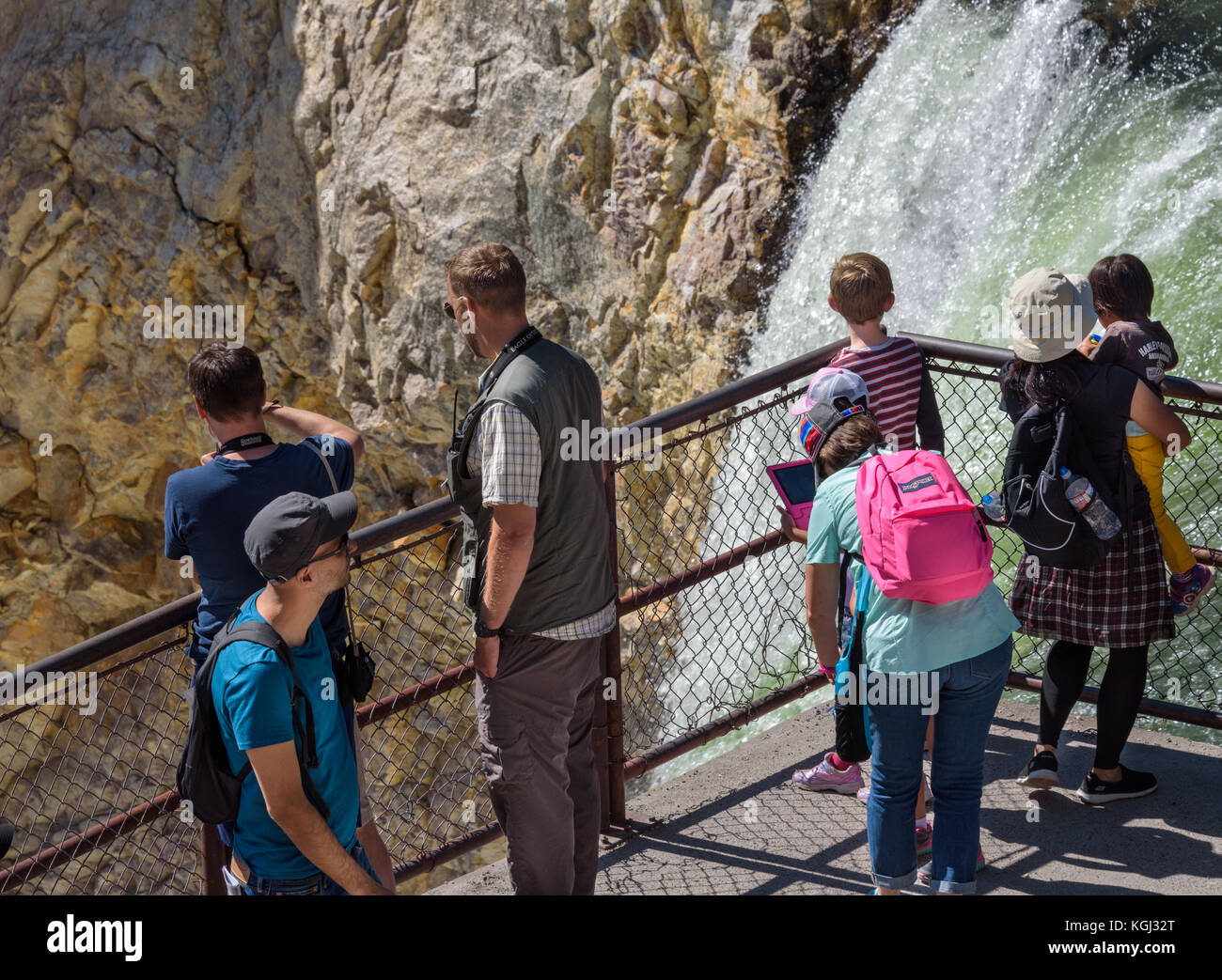 YELLOWSTONE NATIONAL PARK, WYOMING, USA - JULY 17, 2017: Organized group of tourists with a guide watching and taking - Stock Image