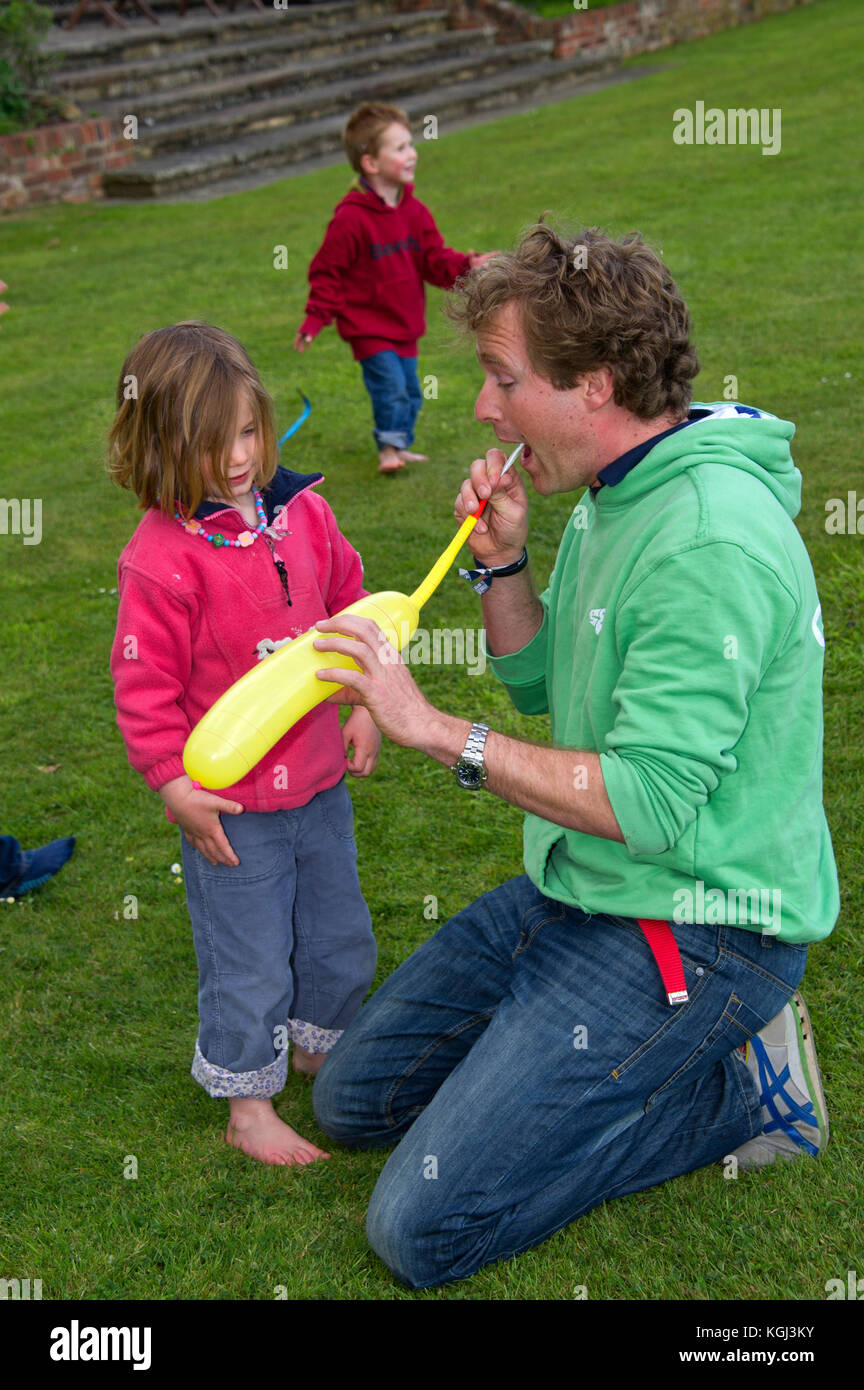 Sharky & George (Charlie Astor, dark hair & George Whitefield) childrens party organisers at a childrens - Stock Image