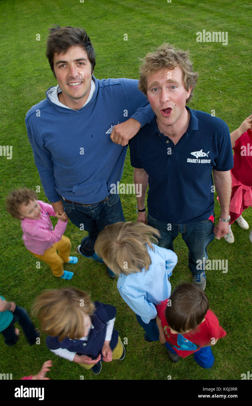 Sharky & George (Charlie Astor, dark hair & George Whitefield) childrens party organisers at a children's - Stock Image