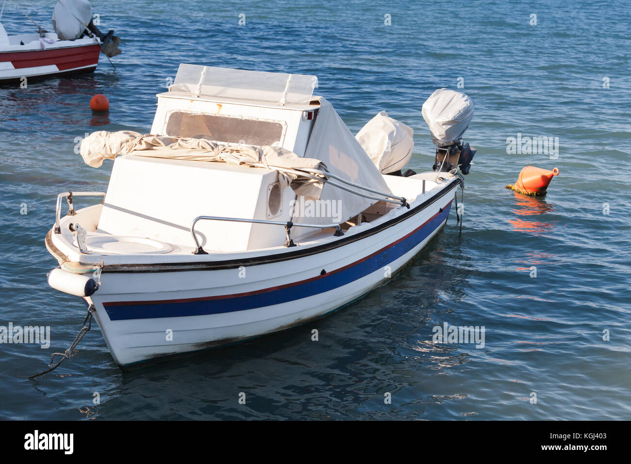 White wooden fishing boat moored in port of Zakynthos, Greek island in the Ionian Sea Stock Photo