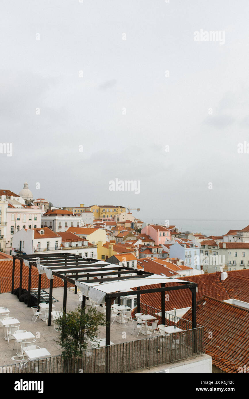 Rooftop bar with view over Alfama district, Lisbon, Portugal - Stock Image