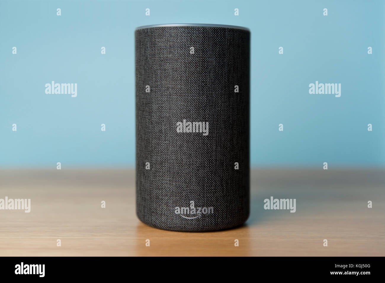 The 2017 release of a charcoal Amazon Echo (2nd generation) smart speaker and personal assistant Alexa shot against - Stock Image