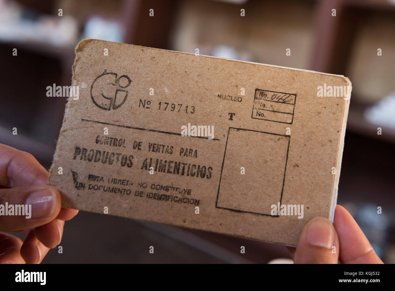 Ration booklet used by Cuban citizens in Government subsidized stores Cuba - Stock Image