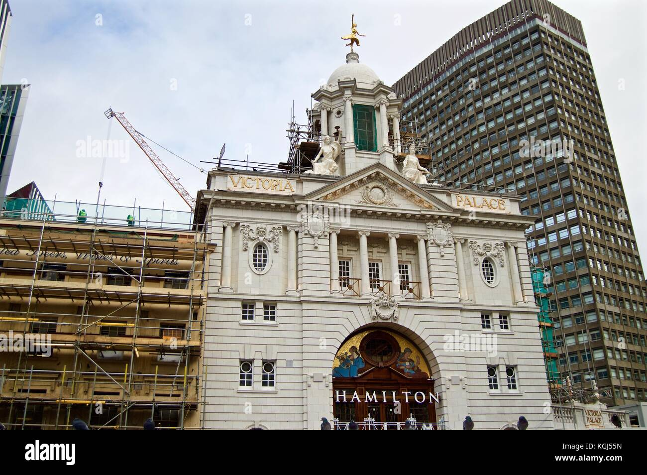 Victoria Palace Theatre undergoing external restoration work with scaffolding on one side, Victoria, London, UK - Stock Image