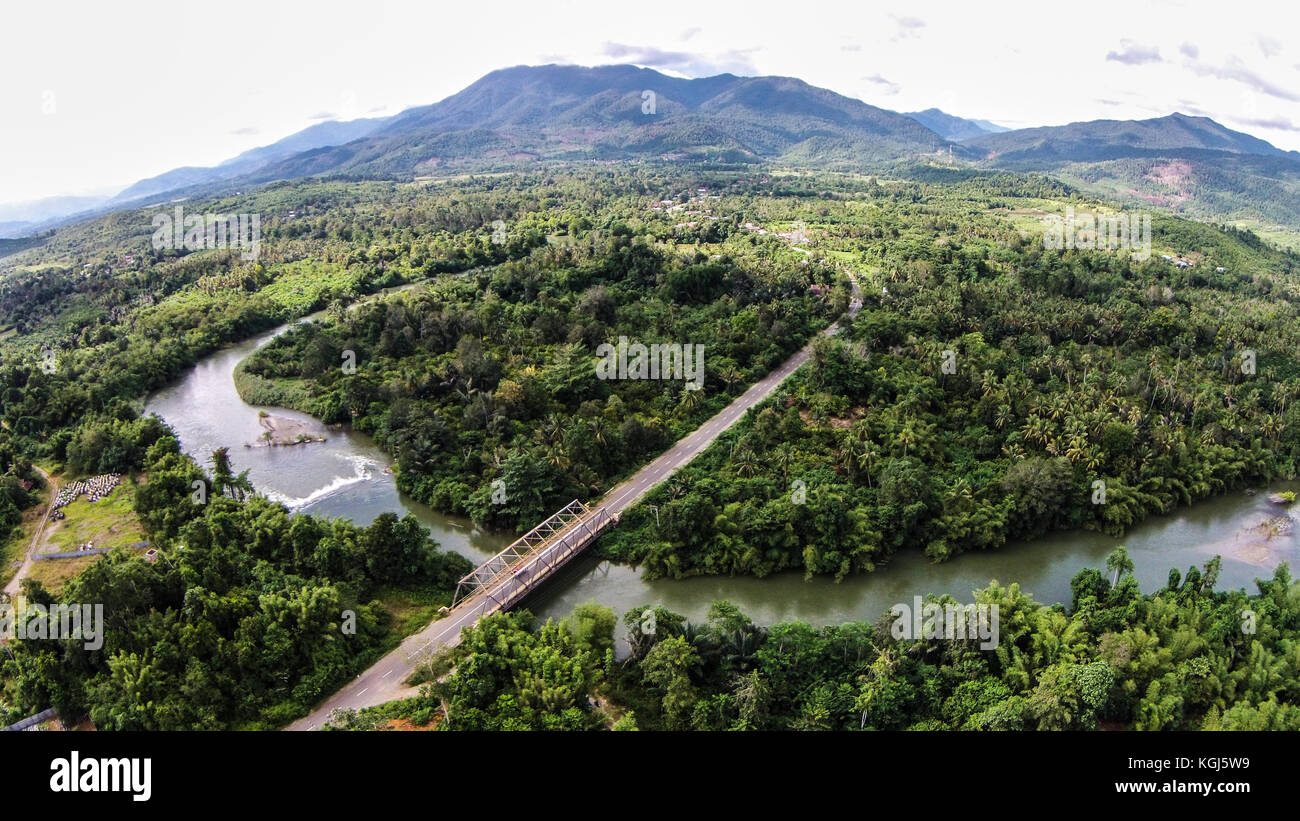 Bridge Infrastructure in Sulawesi - Indonesia with Nickel Verbeek Mountain in the Background. - Stock Image
