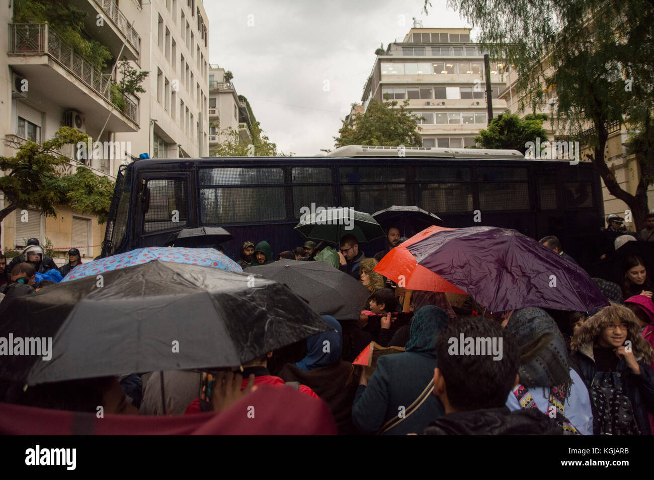 Athens, Greece. 08th Nov, 2017. Refugees holding placards and banners shout slogans as they march to the embassy - Stock Image