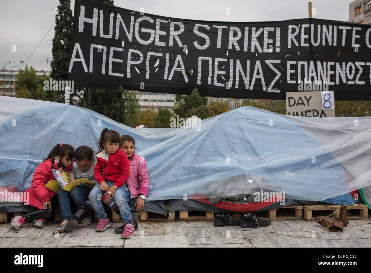 Athens, Greece. 08th Nov, 2017. Refugee kids sit by their tents at Syntagma square in central Athens, Greece, 08 - Stock Image