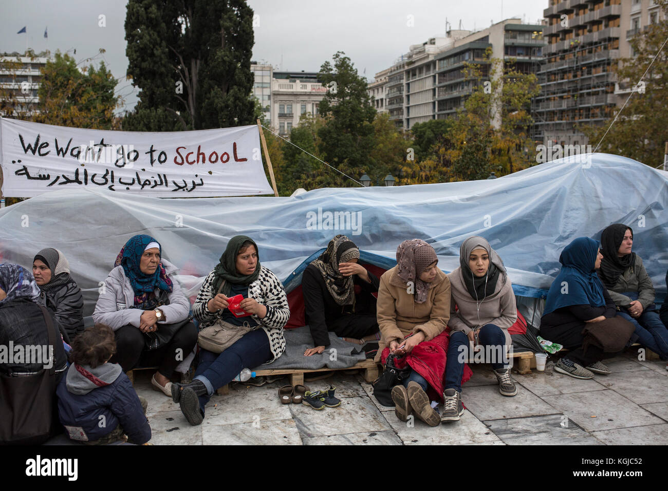 Athens, Greece. 08th Nov, 2017. Refugees sit by their tents at Syntagma square in central Athens, Greece, 08 November - Stock Image