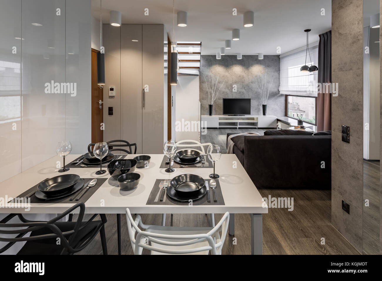 Picture of: Modern Apartment With White Table And Black Dinnerware Stock Photo Alamy