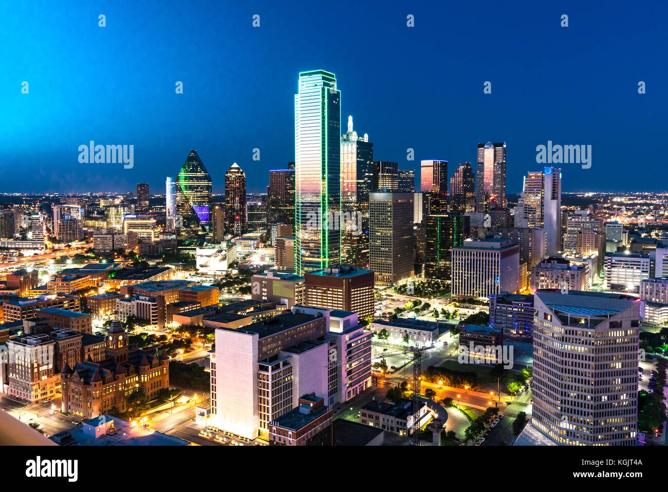Aerial view of Dallas, Texas city skyline at night - Stock Image