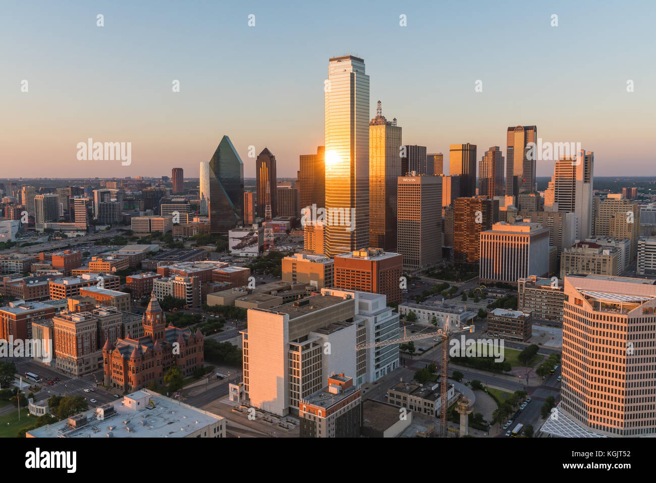 Aerial view of Dallas, Texas city skyline at sunset - Stock Image