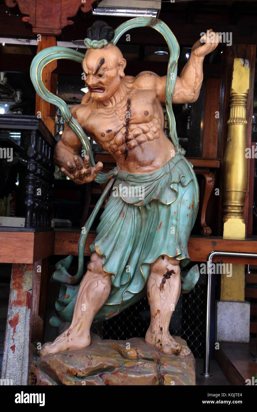 Colombo Sri Lanka Slave Island Gangaramaya Temple Statue of Nio Guardian Misshaku Kongo with mouth open saying the - Stock Image
