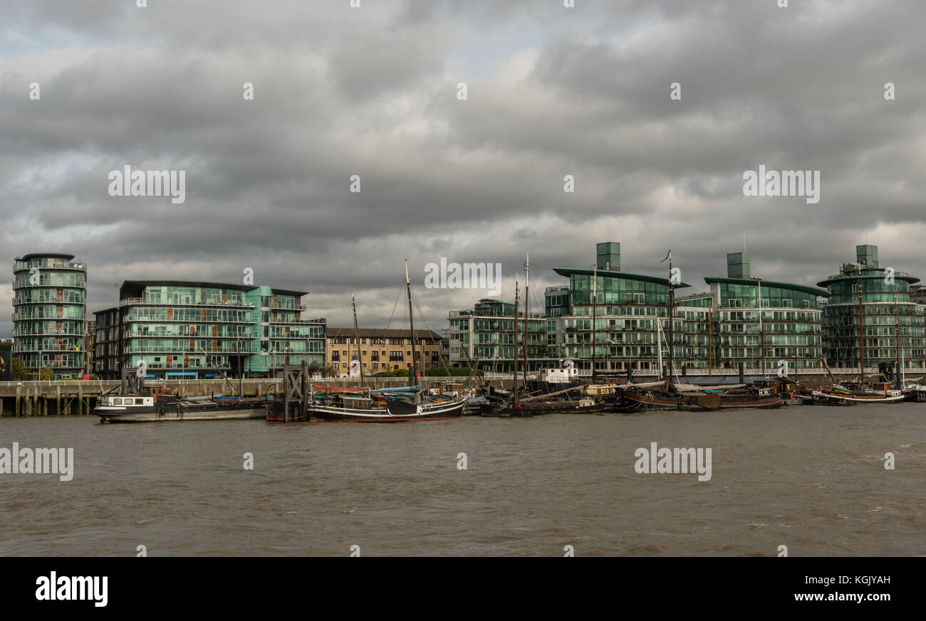 Picturesque East London buildings viewed from the Thames river - Stock Image