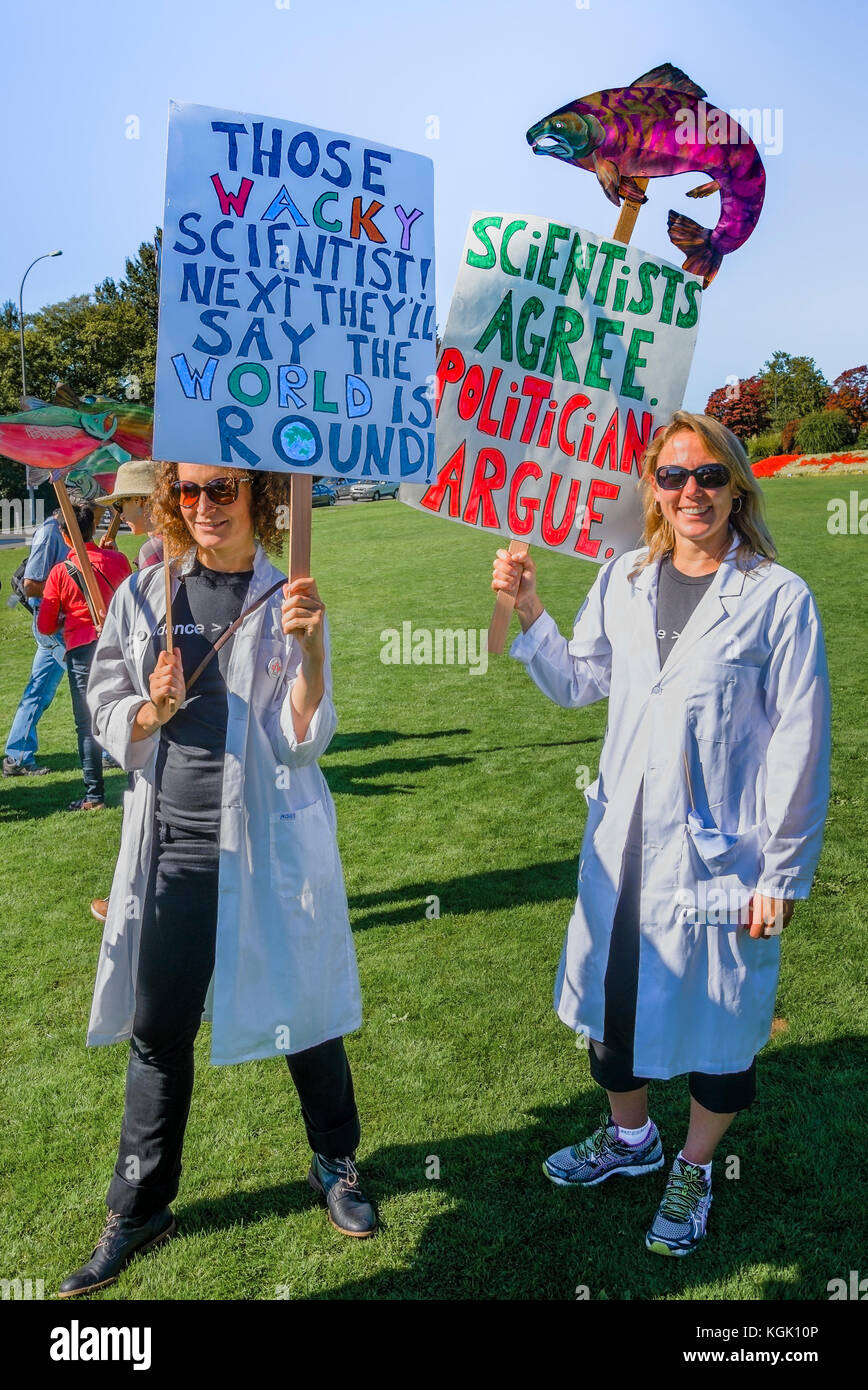 Science vs politics. Climate change knows no borders. International rally at Peace Arch border crossing. Stock Photo