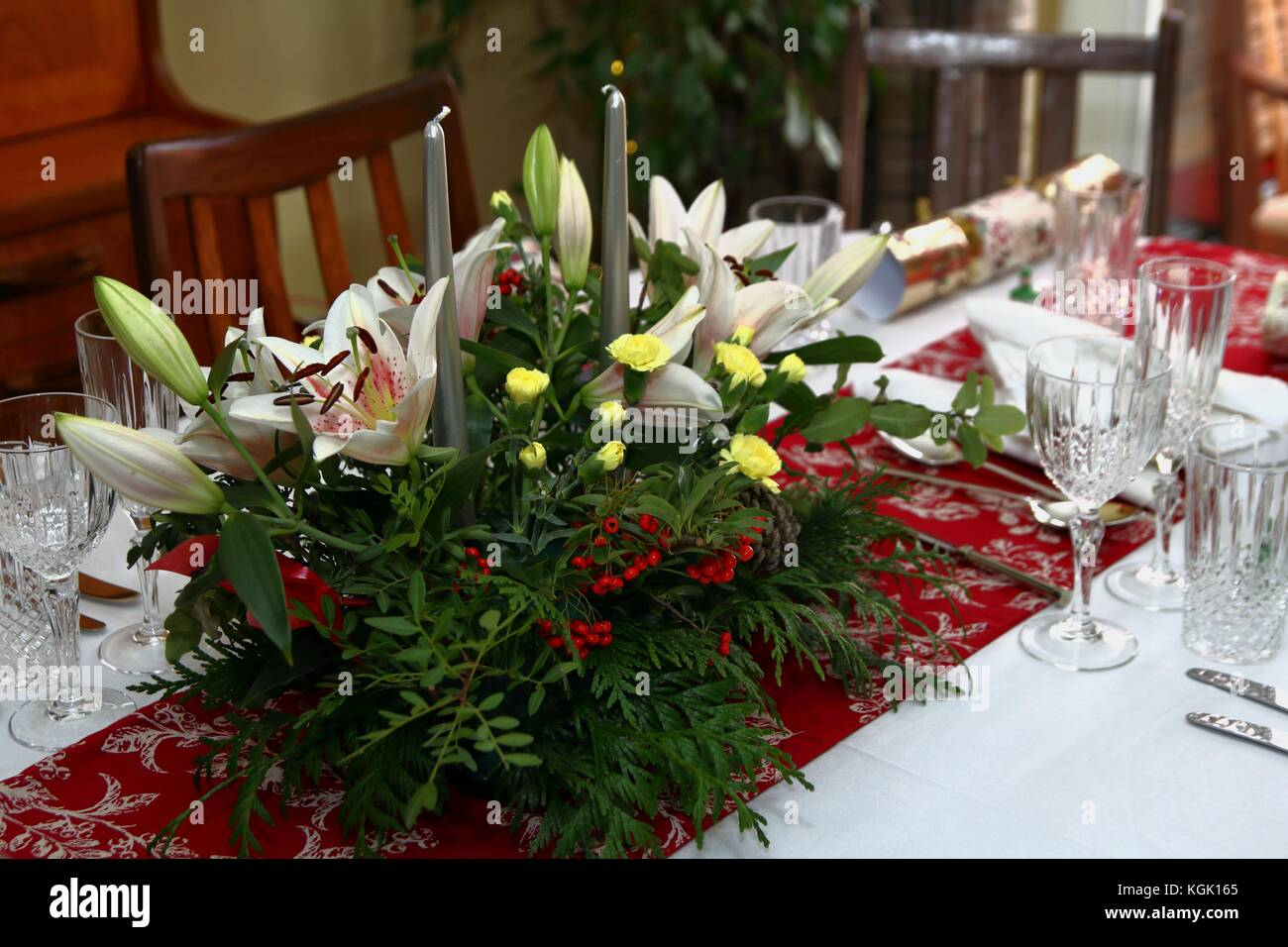 Beautiful Floral Centerpiece With Candles On A Festive Dining Table Laid  Ready For Christmas Dinner In A Traditional Home