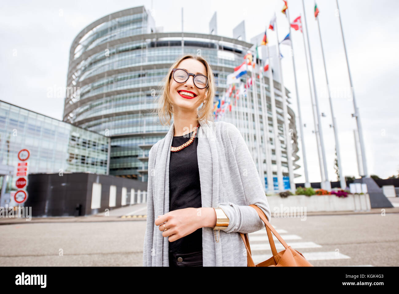 Woman near the European parliament building in Strasbourg - Stock Image