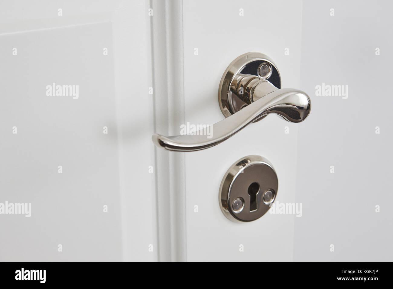 Metallic Classic Door Knob On A White Door. Open Closed