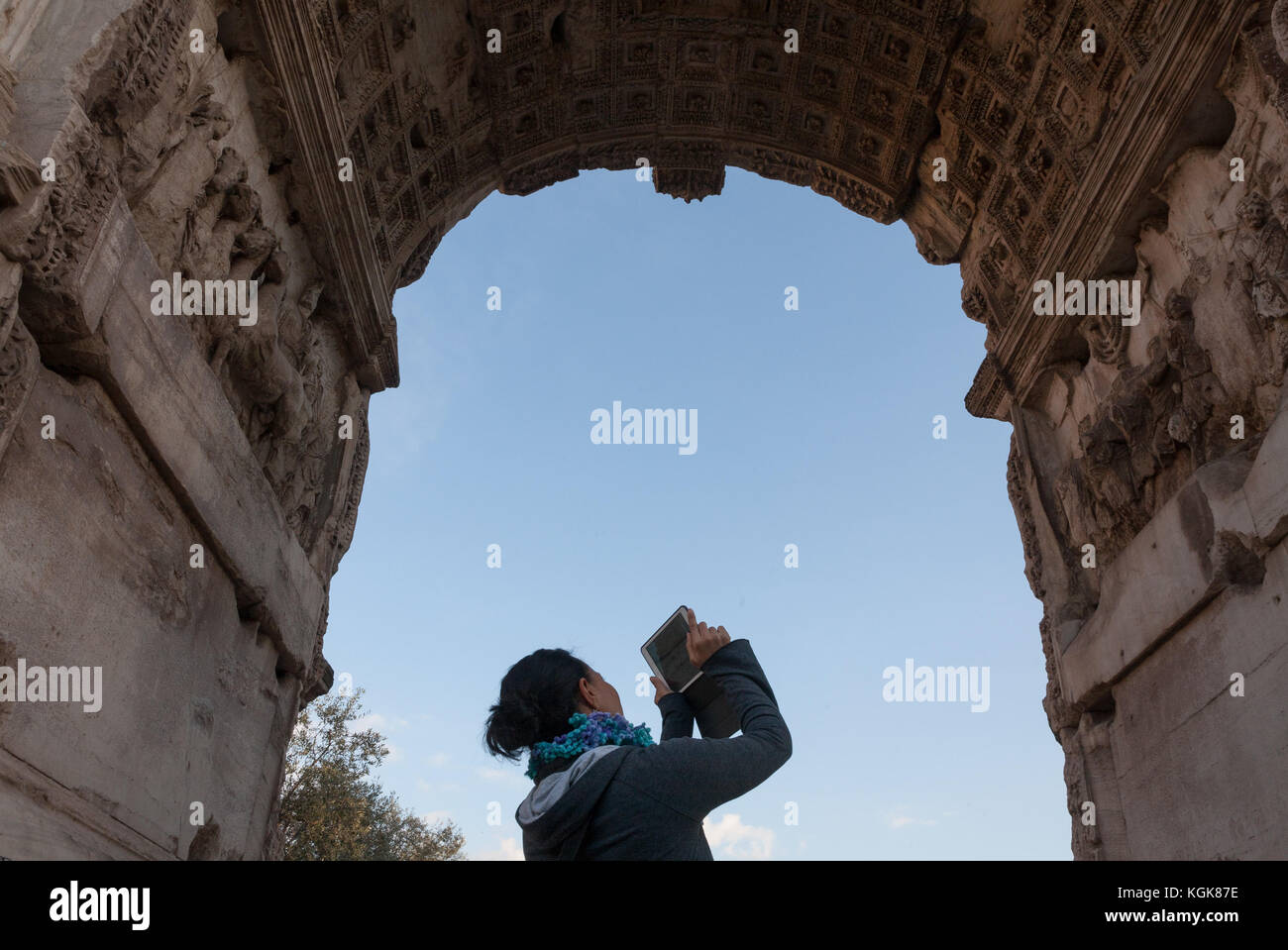 A tourist is taking a picture in the Roman Forum, Rome, Italy. Stock Photo