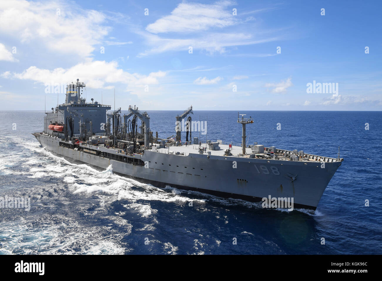 The Henry J. Kaiser-class fleet resupply oiler USNS Big Horn (T-AO 198) is underway in the vicinity - Stock Image