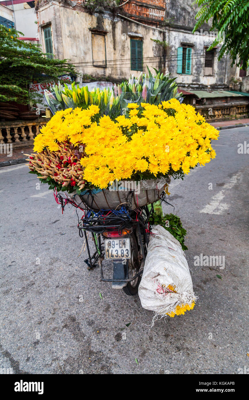Small Motorcycle Fully Loaded With Flowers In Central Hanoi, Vietnam. The  Flowers Will Be