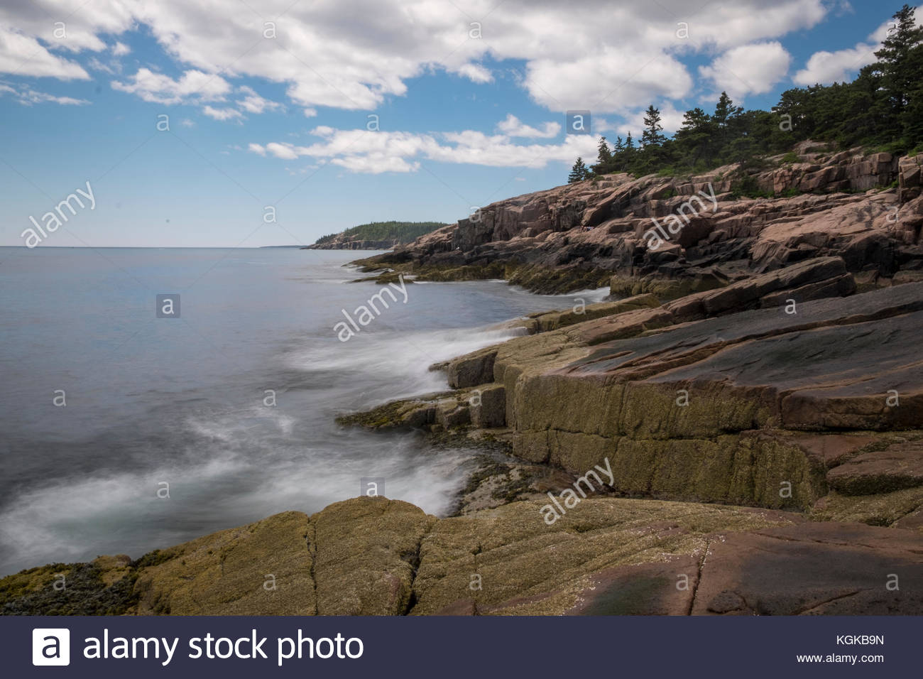 The rocky shoreline at Acadia National Park. - Stock Image