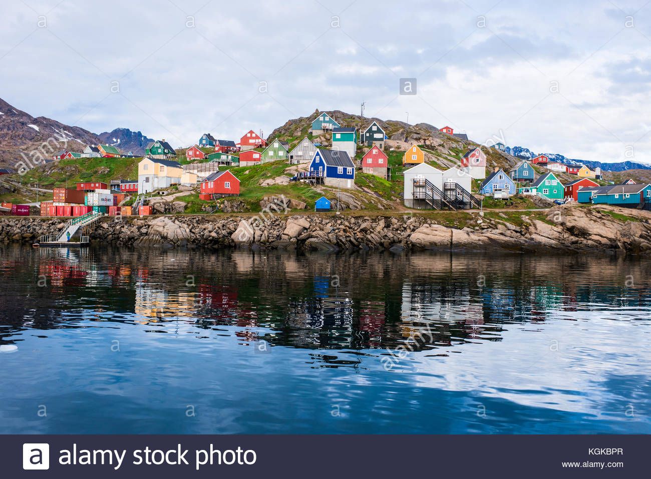 Lots of typical Greenlandic colorful houses on the shore of a fjord in summer. - Stock Image