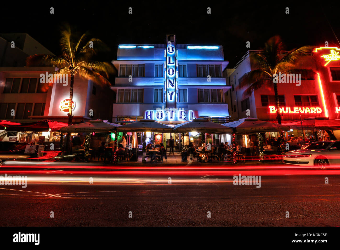 Light trails from cars and traffic in front of the Colony Hotel and other Art Deco buildings on Ocean Drive, South - Stock Image