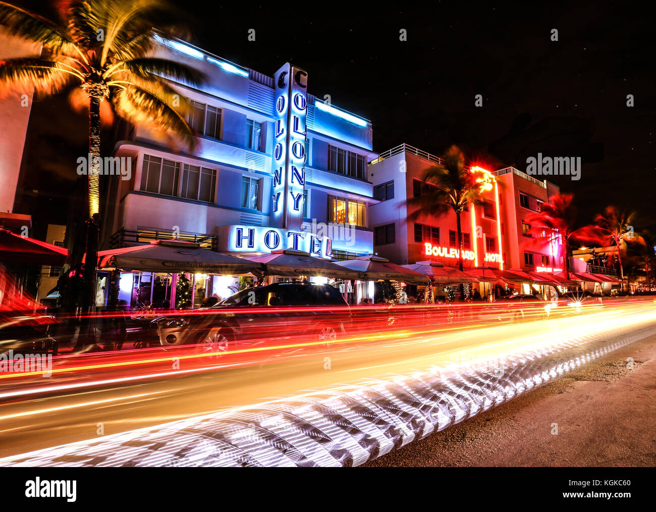 Long exposure of traffic on Ocean Drive in South Beach, Miami, Florida, USA, in front of the Colony Hotel and other - Stock Image