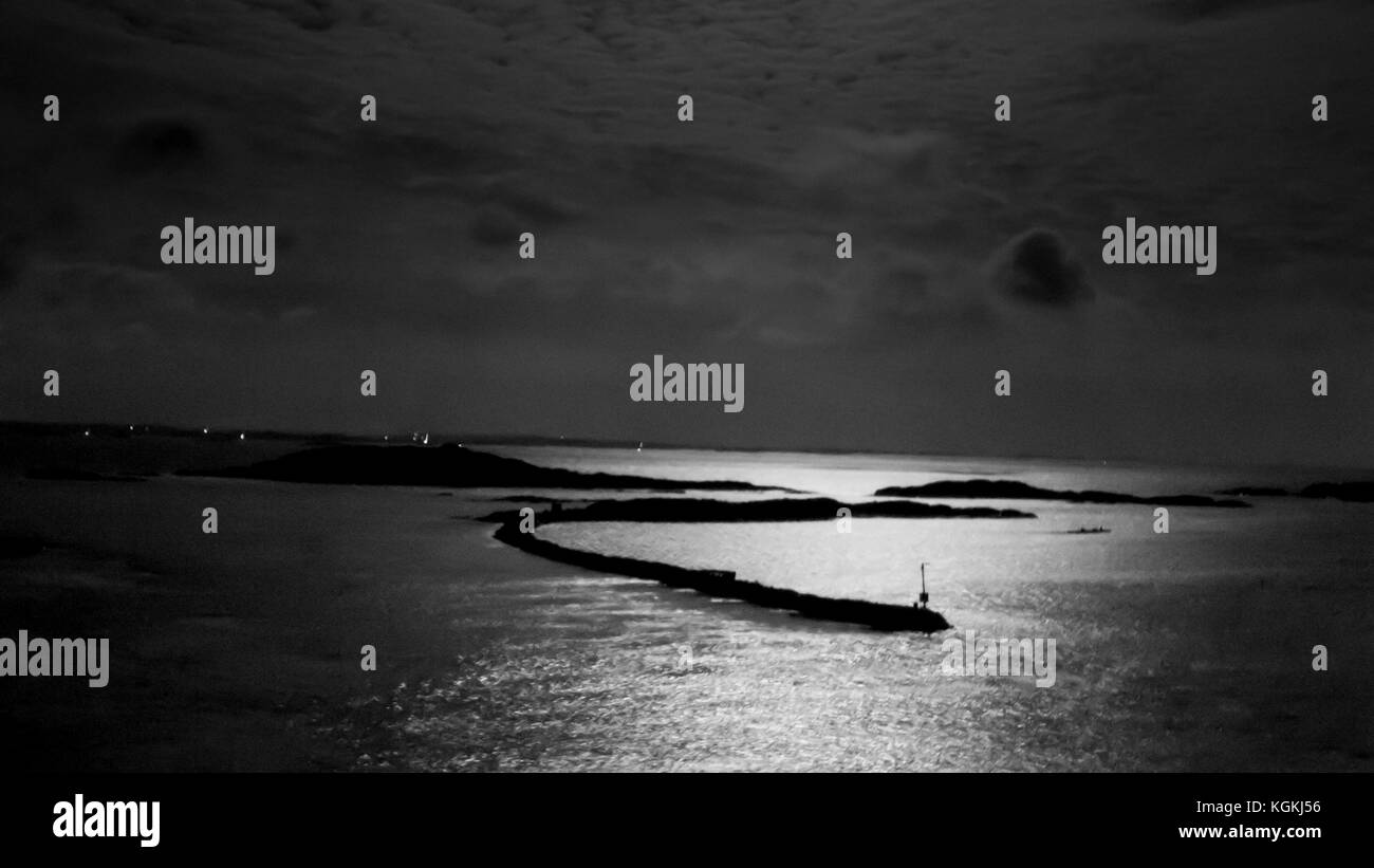 View from the Fotö bridge overlooking the Gothenburg archipelago a moonlit night - Stock Image