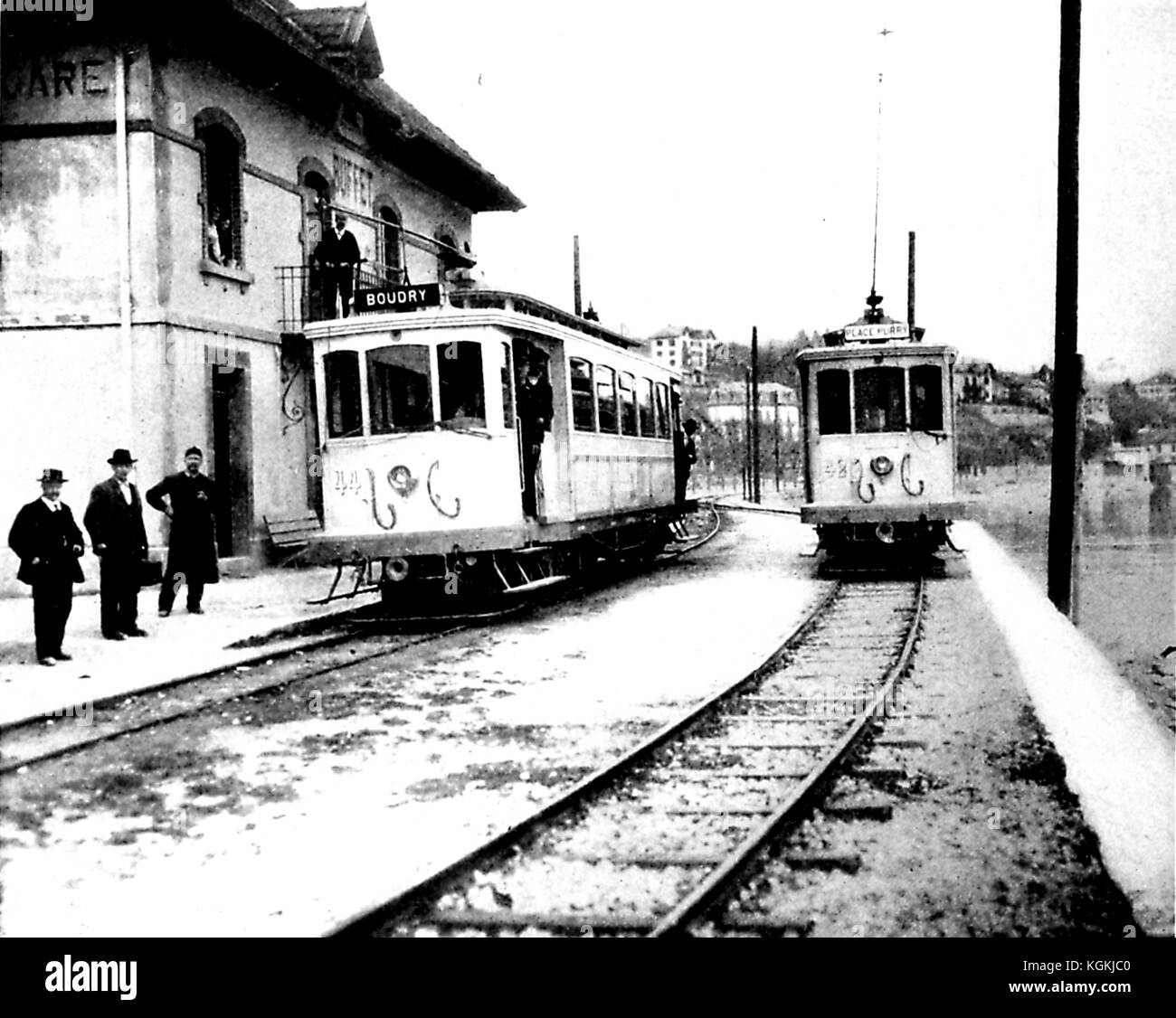 Photograph of an early electric train line connecting Neuchatel, Switzerland with Boudry, Switzerland, with men - Stock Image