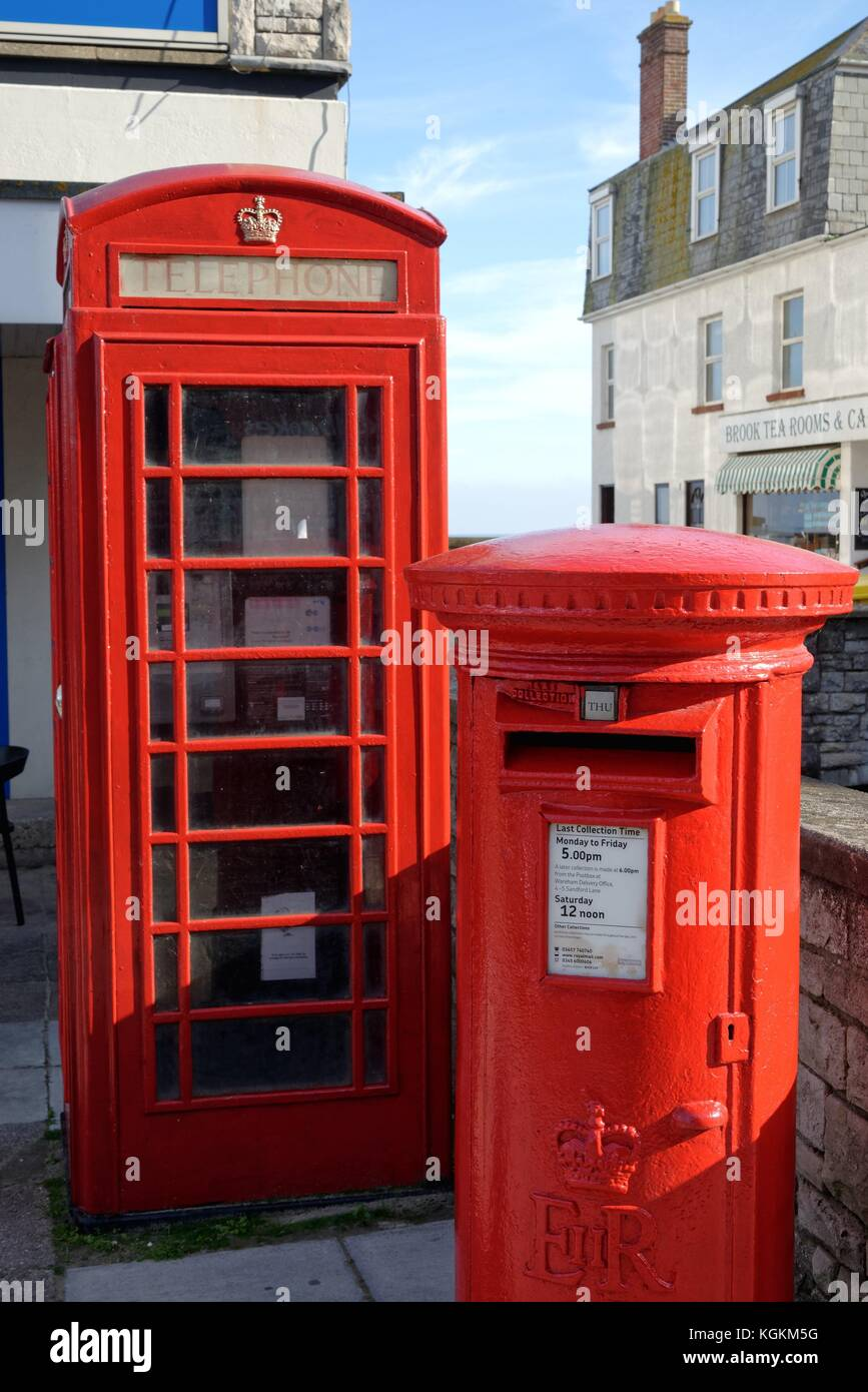 Red telephone kiosk and red post box in Swanage Dorset England UK - Stock Image