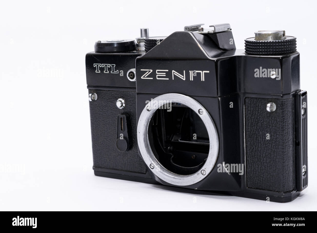 Old Soviet Zenit TTL 35 mm film camera isolated on white - Stock Image