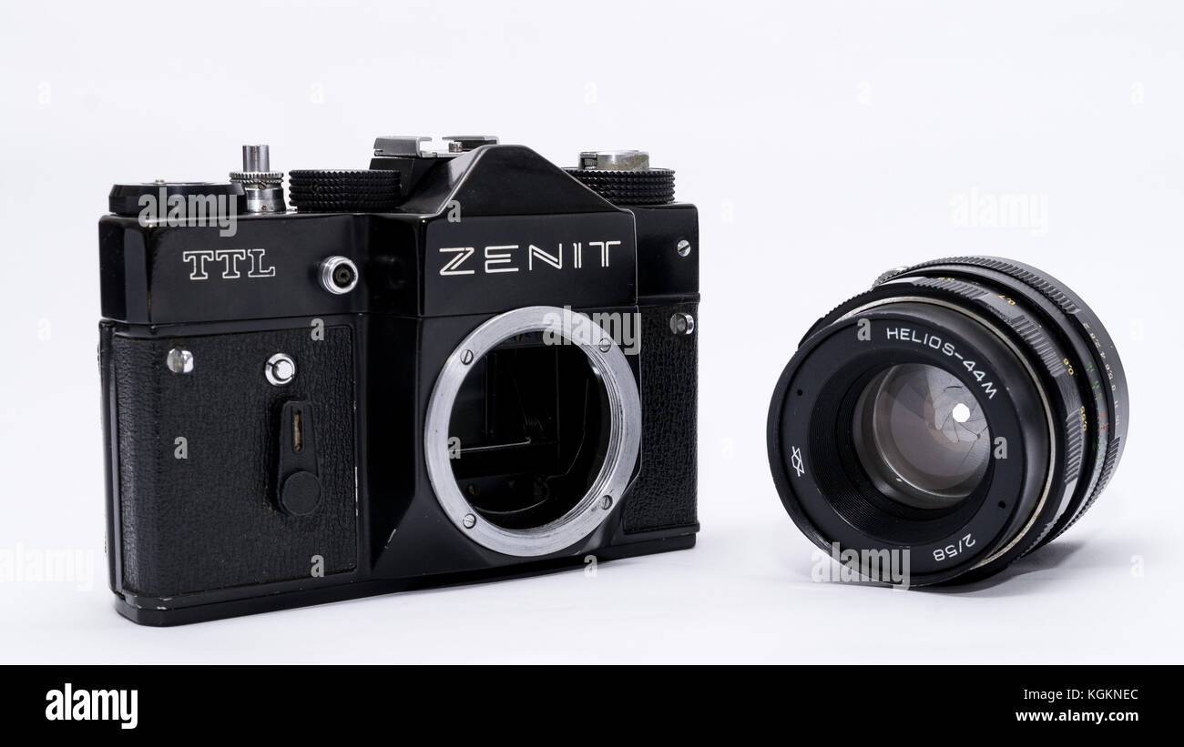 Old Soviet Zenit TLL 35 mm film camera isolated on white with Helios 44-2 lens - Stock Image
