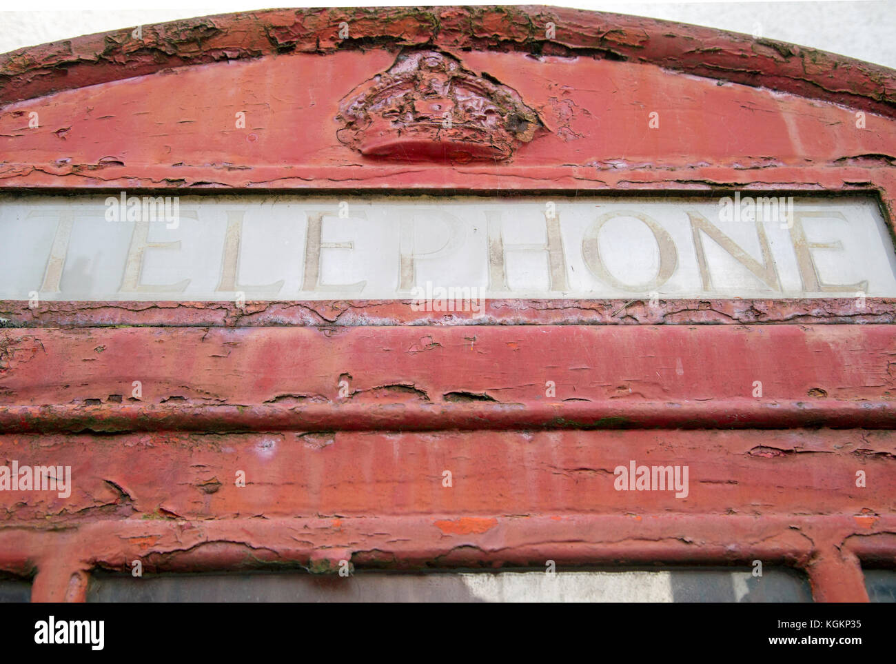 Old fashioned red telephone box close up - Stock Image