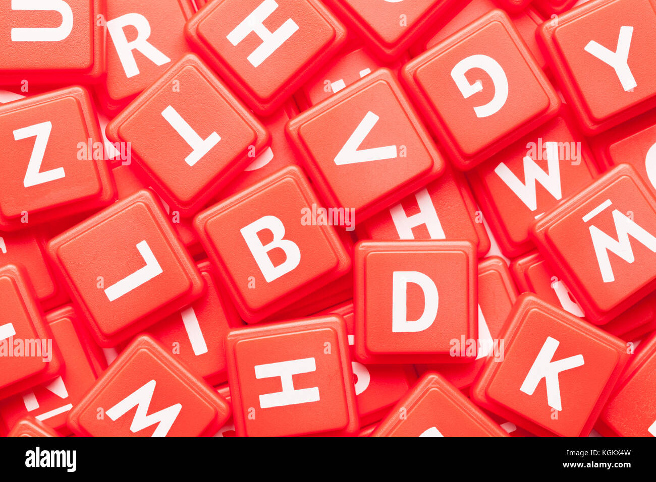 Pile of Red Letter Game Tiles Background. - Stock Image