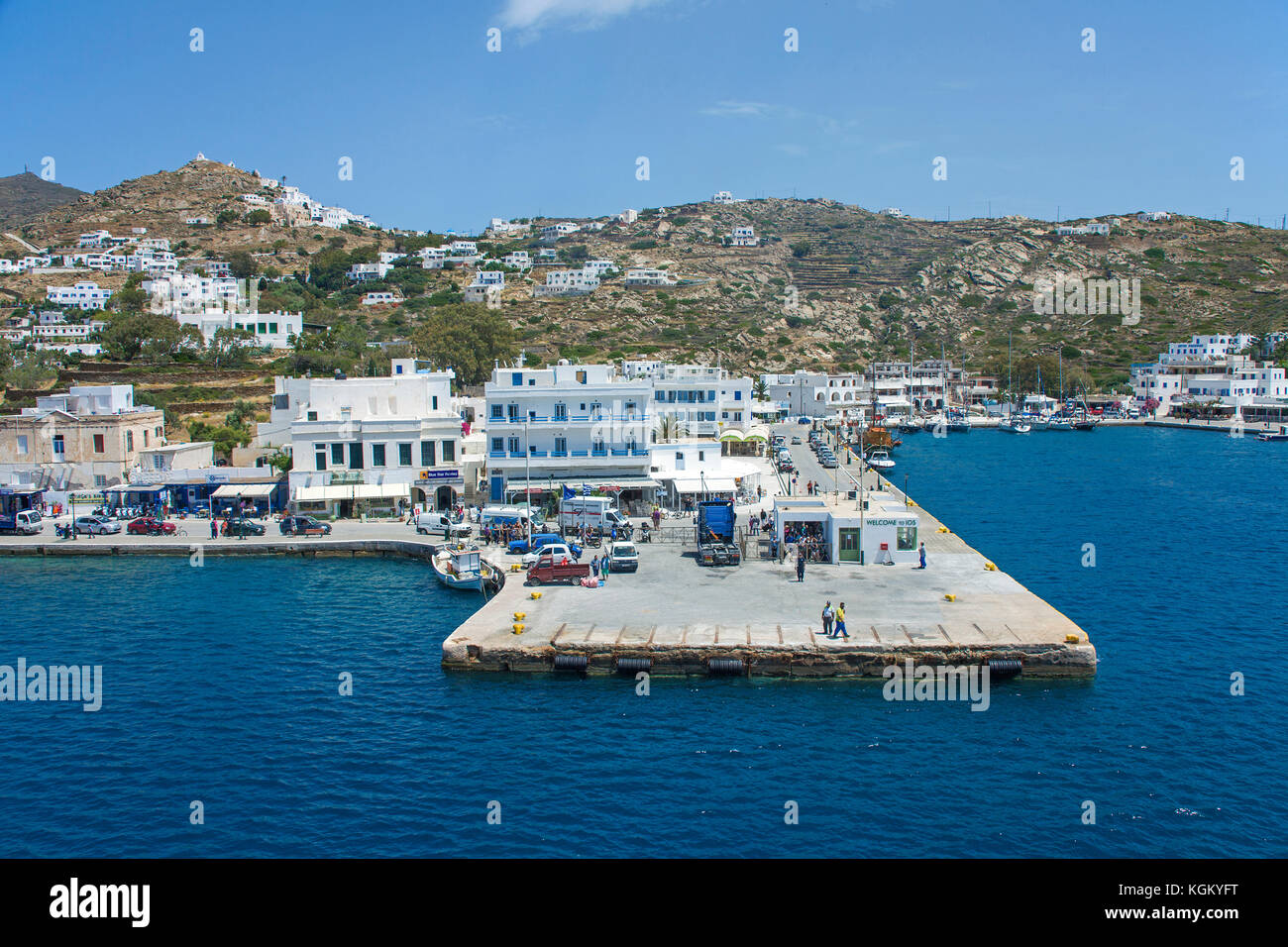 Pier and harbour of Ormos, Ios island, Cyclades, Aegean, Greece - Stock Image