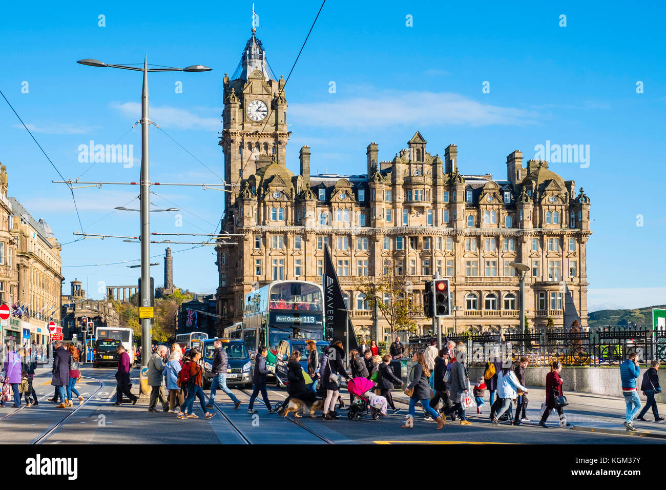View along Princes street to the  Balmoral Hotel with busy pedestrian crossing Edinburgh , Scotland, United Kingdom. - Stock Image