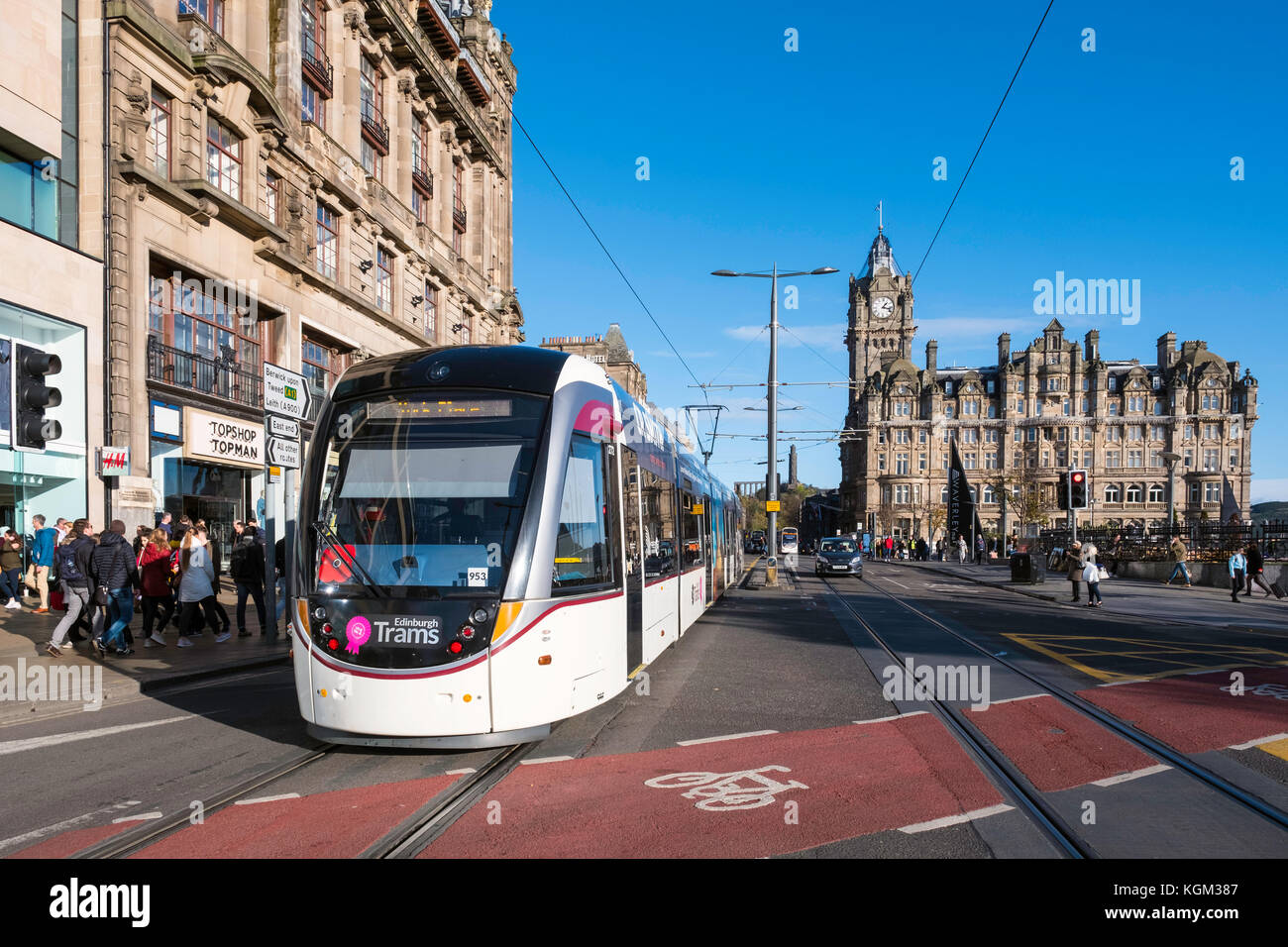 View along Princes street with tram and Balmoral Hotel visible in Edinburgh , Scotland, United Kingdom. Stock Photo