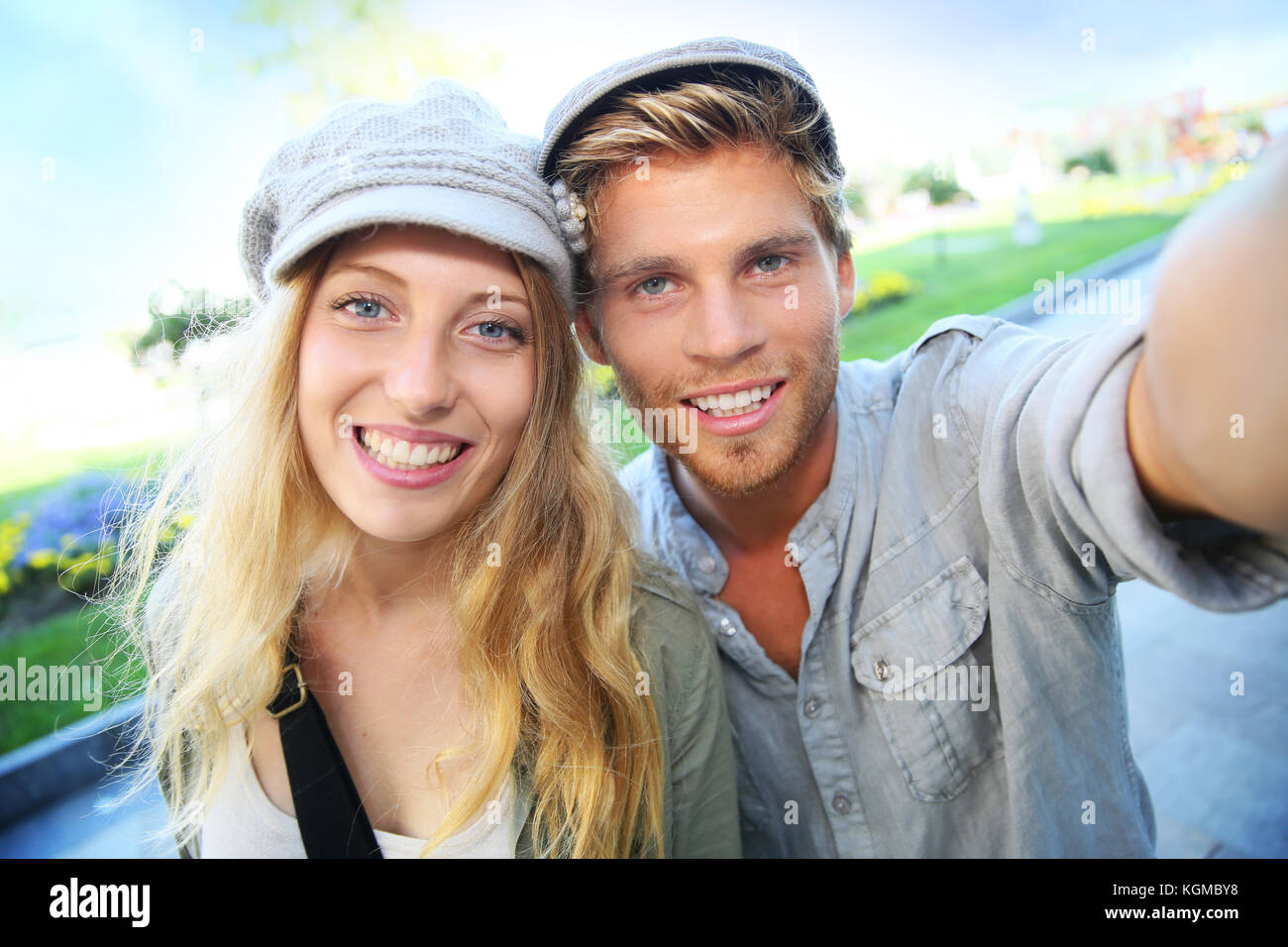 Cheerful trendy couple taking self-portrait picture - Stock Image