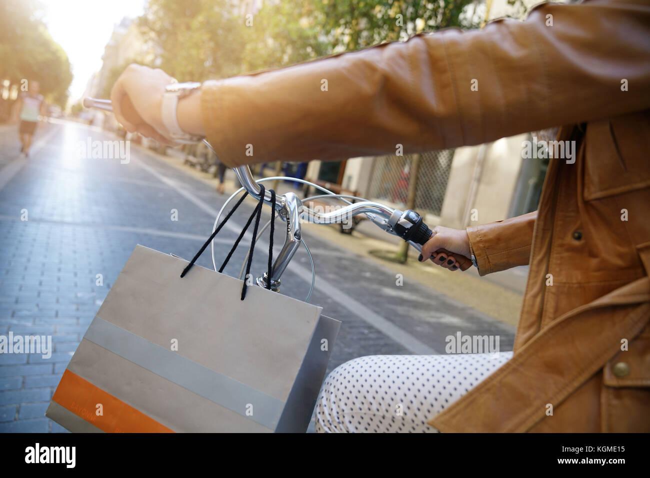 Closeup of woman riding bike in town - Stock Image