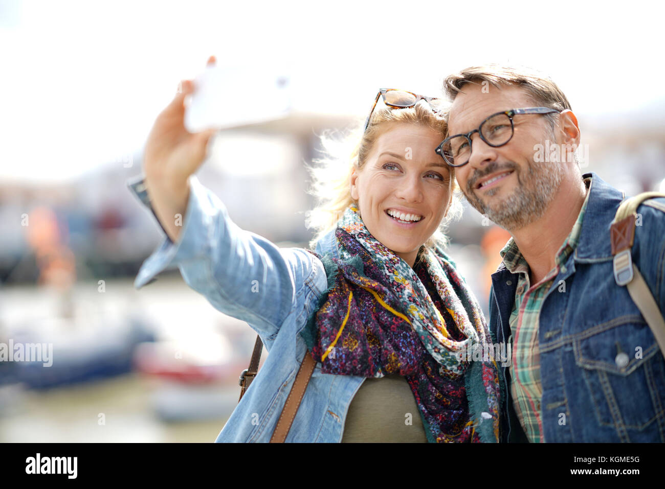Couple of tourists on vacation taking selfie picture with smartphone - Stock Image