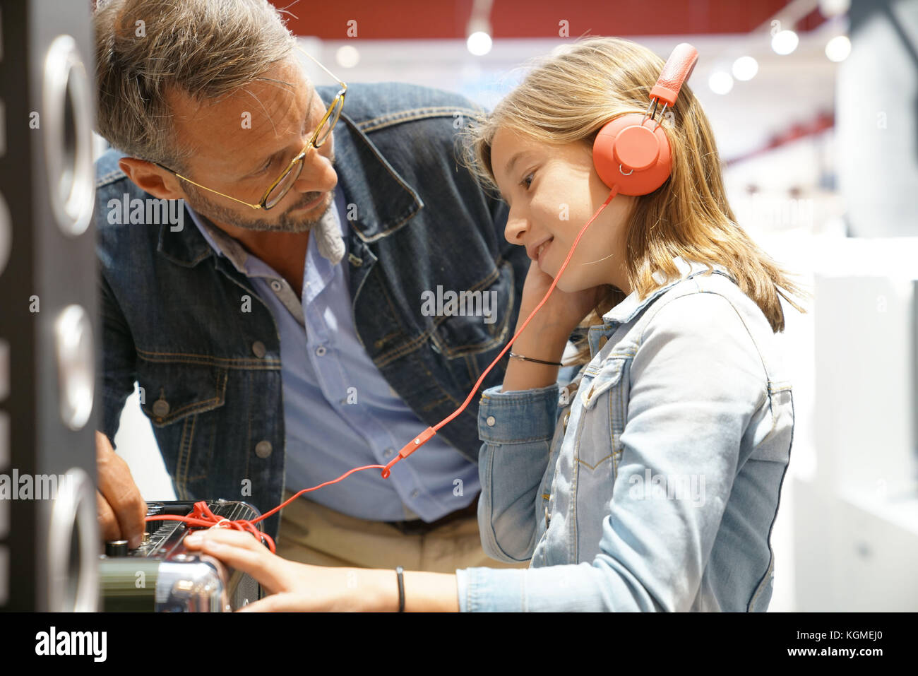 Father and daughter checking music in multimedia store - Stock Image