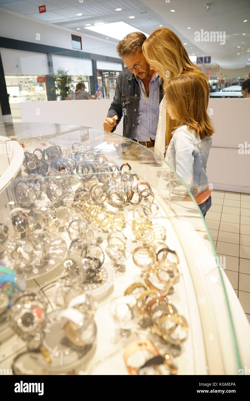 Family in shopping mall looking at jewelry department - Stock Image