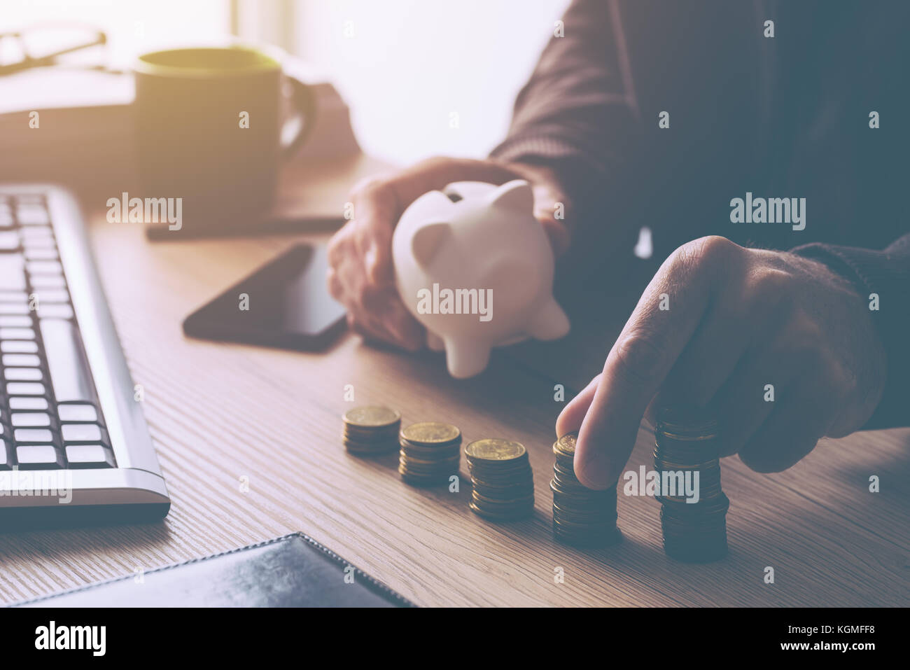 Home budget calculation, man working financial figures. Salary, expenses, taxes and expenditure. Retro toned image Stock Photo